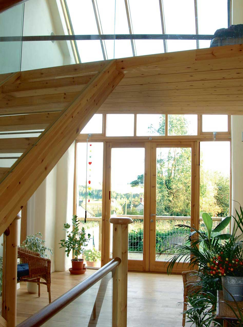 The entrance to the house forms part of a 'glass wall' that runs along the centre of the house
