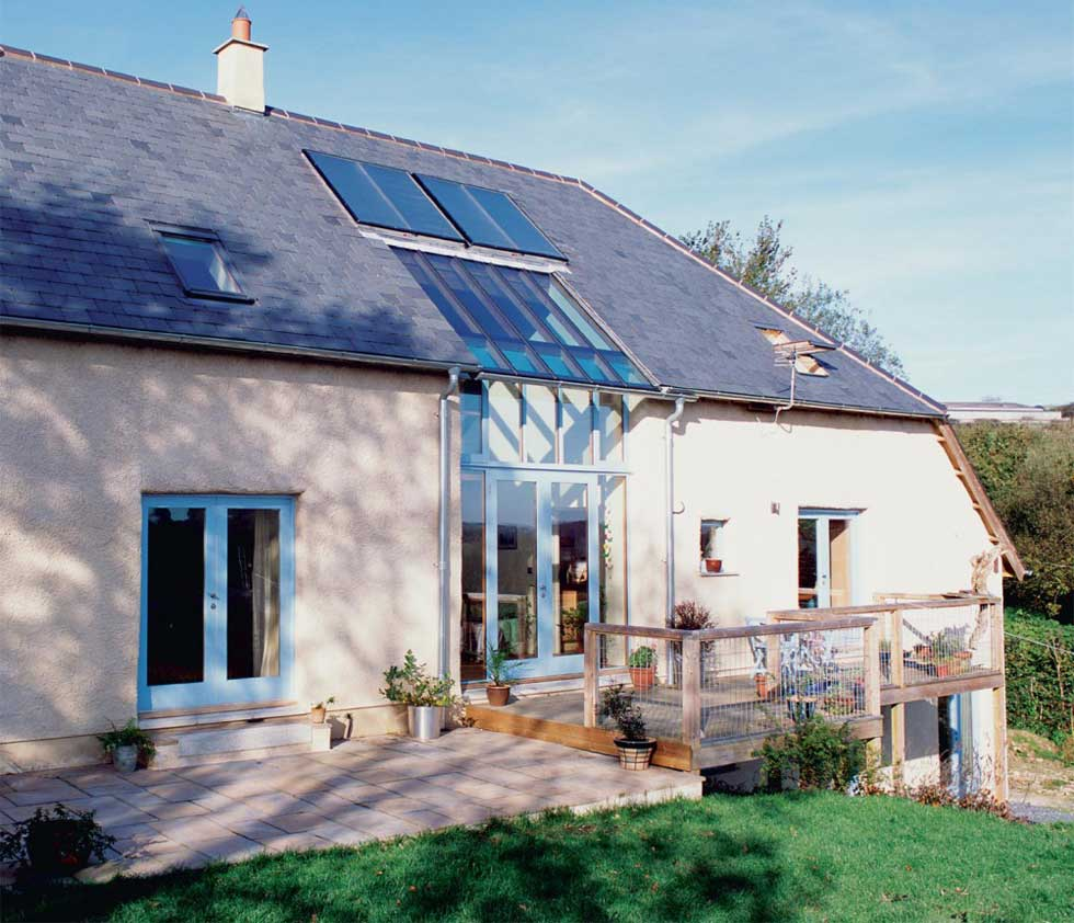 The self build was built using cob and includes solar panels on the roof