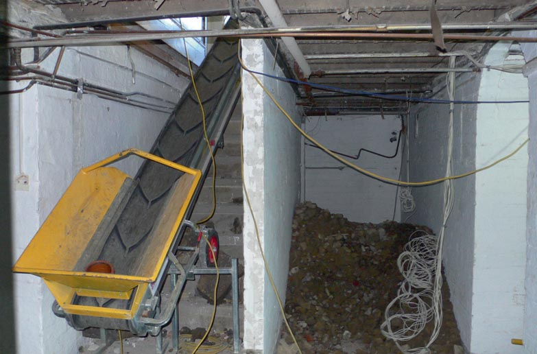 Work began with demolishing the external cellar wall and excavating the underground space