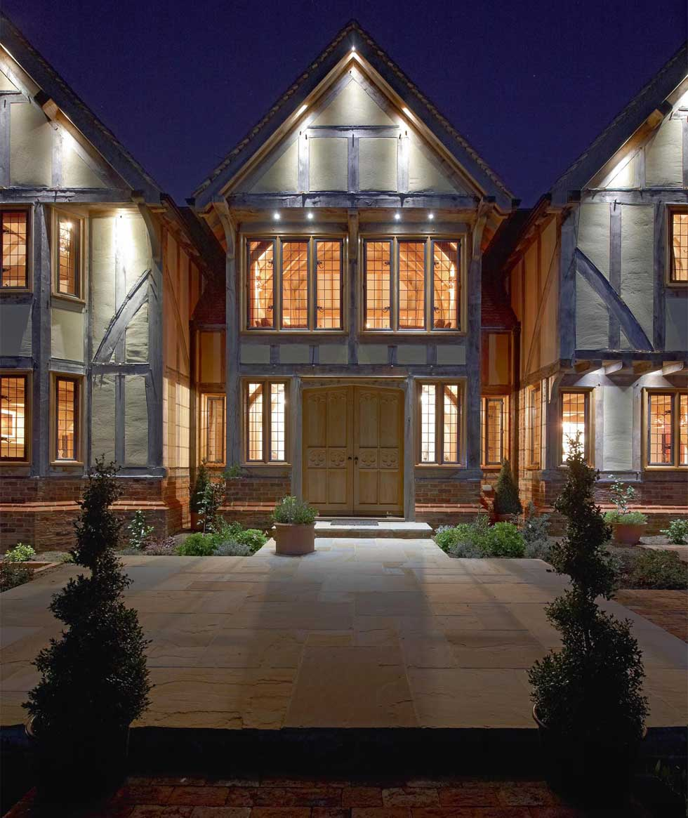 Front elevation of an oak frame self build at night