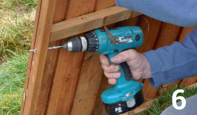 While the paint is drying drill four evenly spaced pilot holes through the side bars on both sides of each fence panel