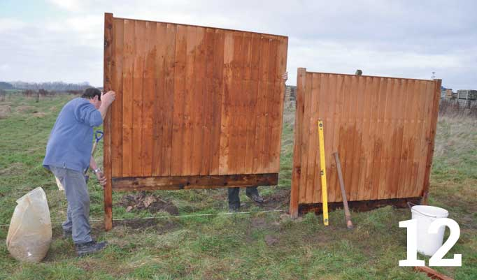 With the first panel secure, fix a post to one edge of the next fence panel