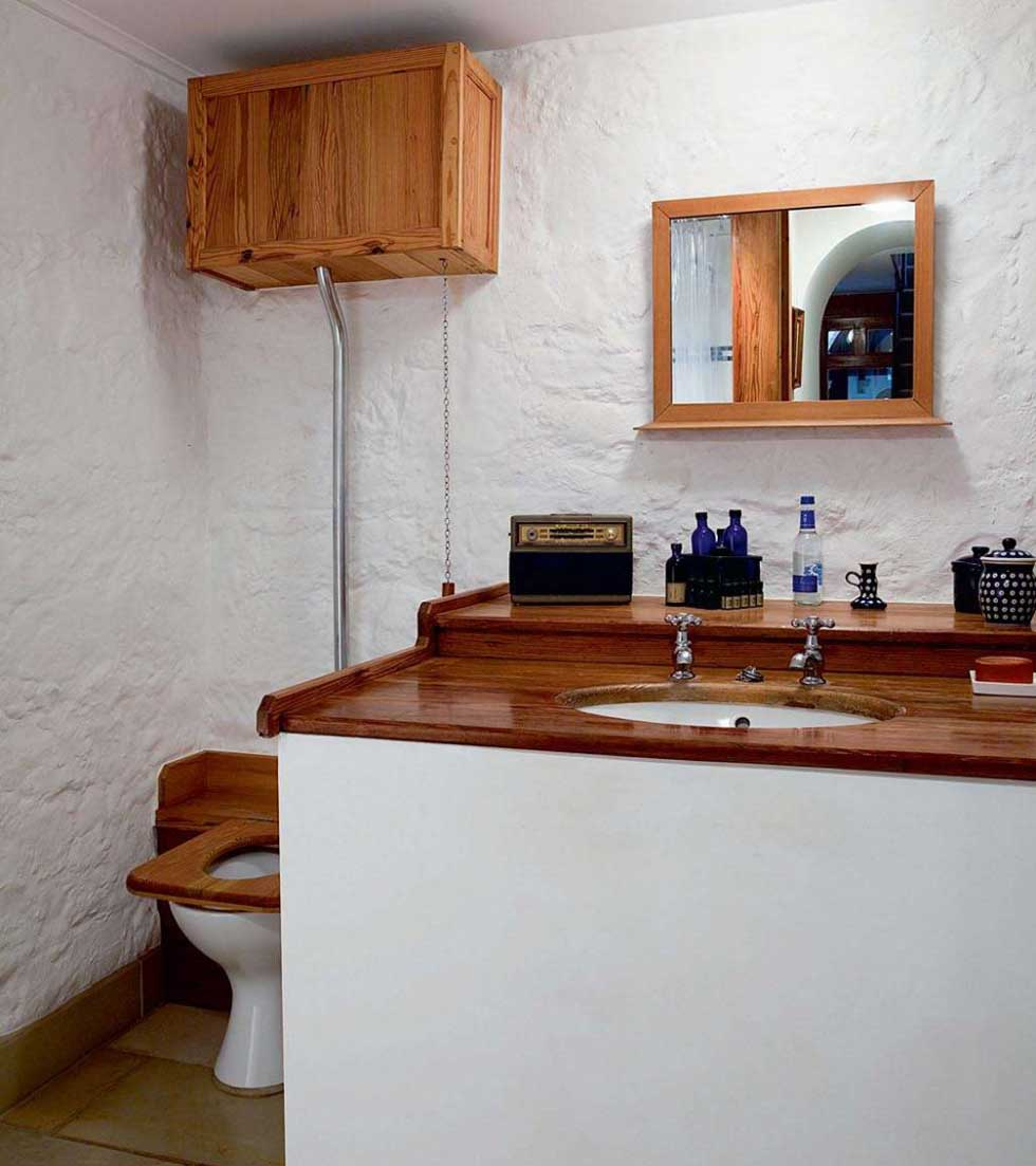 The bathroom furniture and high level cistern toilet