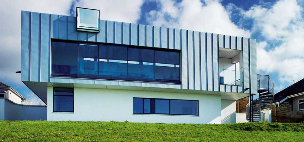 Zinc clad cliff-top self build house