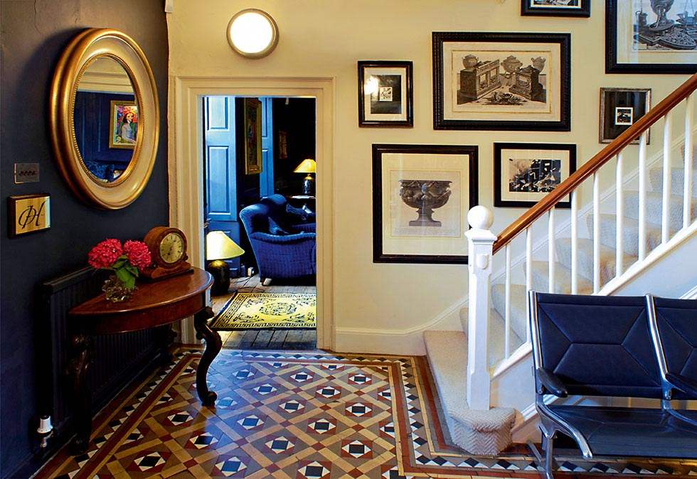 The hallway with encaustic floor tiles