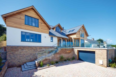 contemporary oak frame home on a sloping site