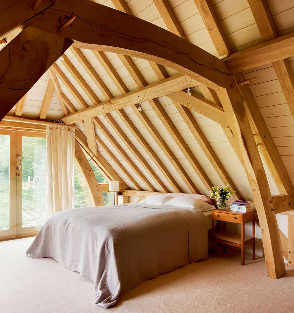 The master bedroom with exposed wooden ceiling beams