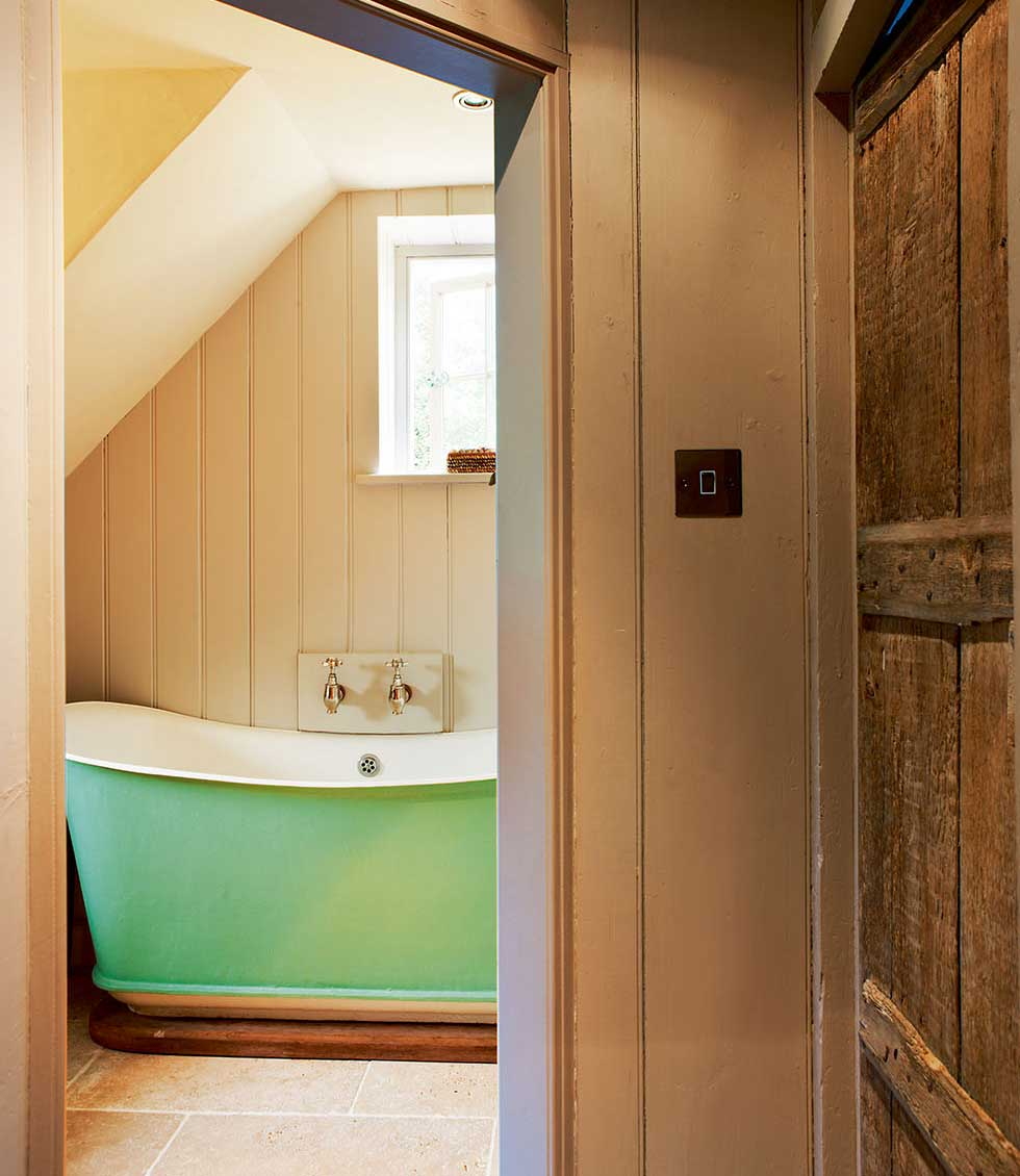Painted freestanding bath in the bathrrom