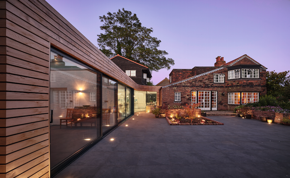 This extension to a listed property by Pow Architects has been clad in timber to contrast against the period home