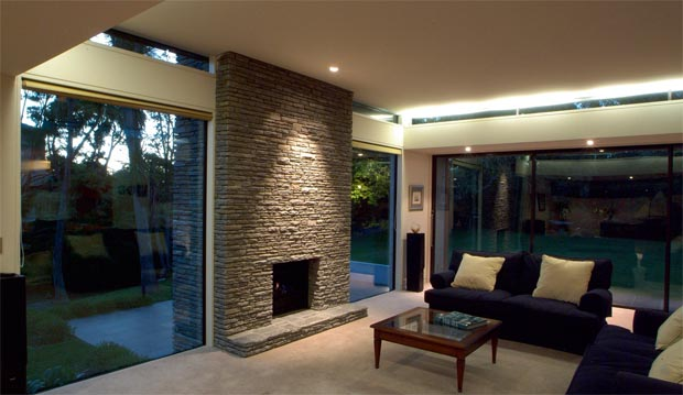 Floor-to-cciling windows bring the outdoors inside and provide lots of natural light