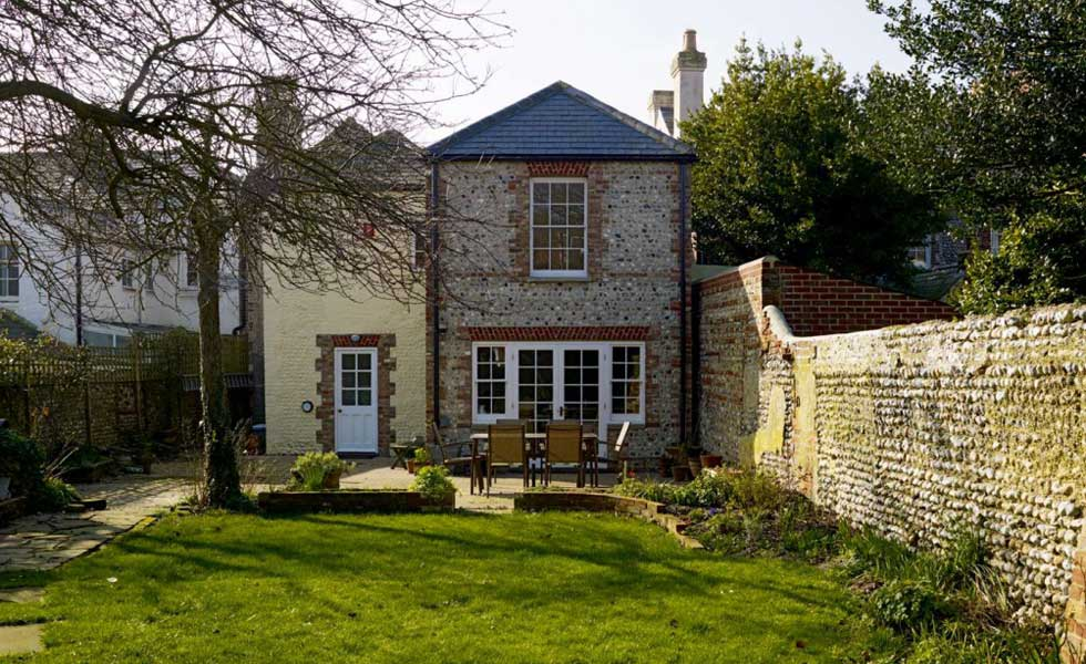 The rear of an extended Grade II Listed house