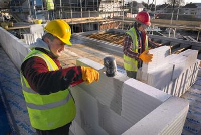 Builder working on blockwork wall