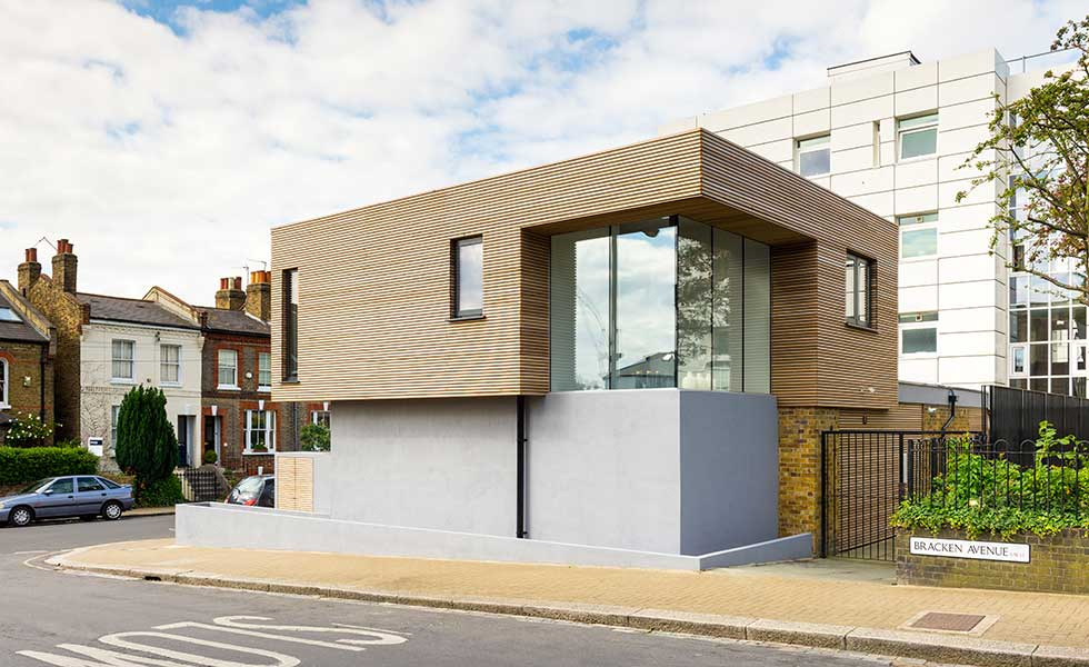Updated house with timber cladding and render