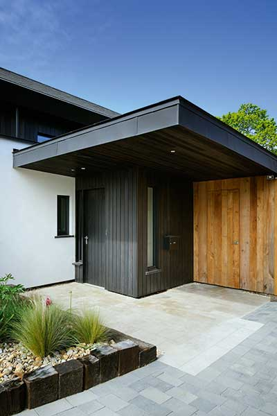 Fir cladding with oak and render
