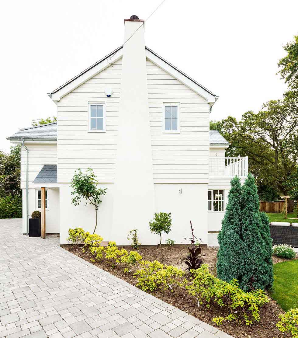 The tall chimney stack on this project is typical of New England style homes