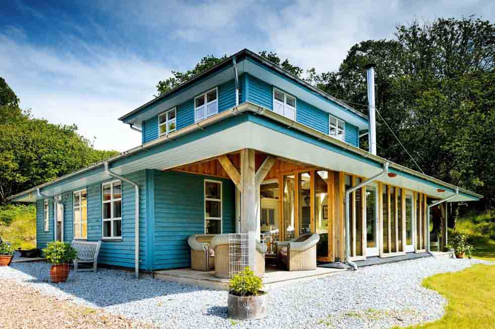 This New England style self build features a covered porch area to shelter the entrance door