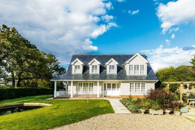 This self build has been designed in the New England style complete with dormer windows and a veranda