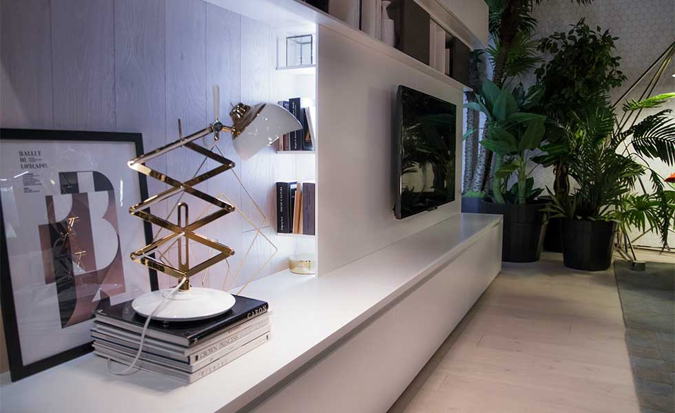 Contemporary sleek white living room storage with retro side lamp