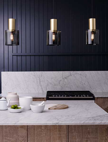 Kitchen island with marble and three pendant lights