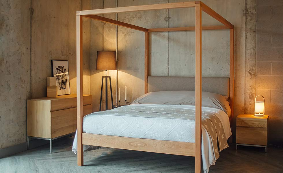 Contemporary bedroom with four poster bed