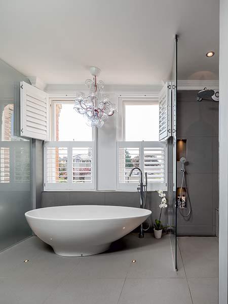 Bathroom with egg shaped bath and grey walls