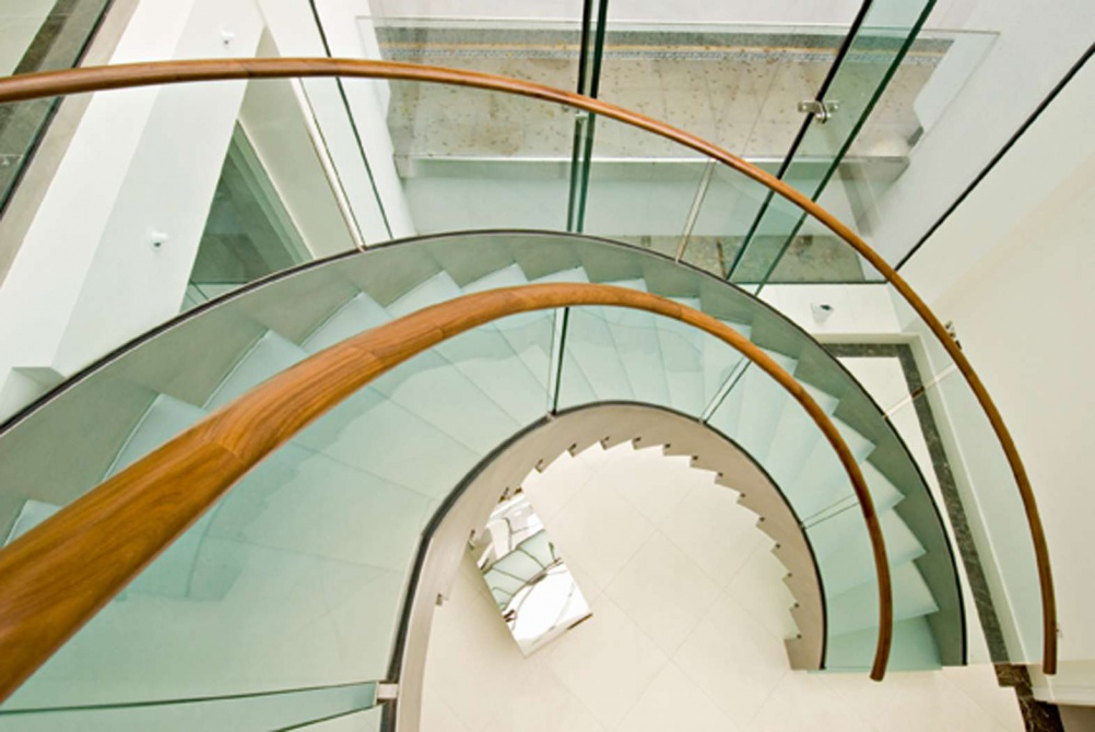 Glass topped with American black walnut handrails by Bisca