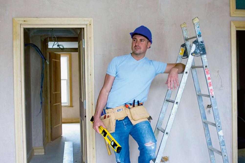 Builder leaning against a stepladder