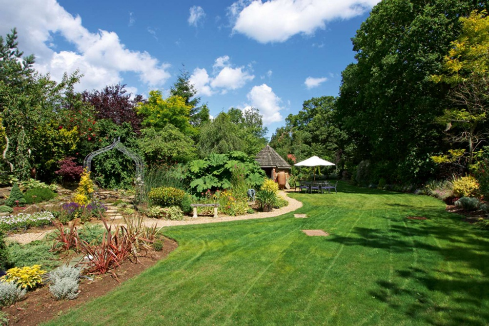 garden landscaping with large lawn and mature borders