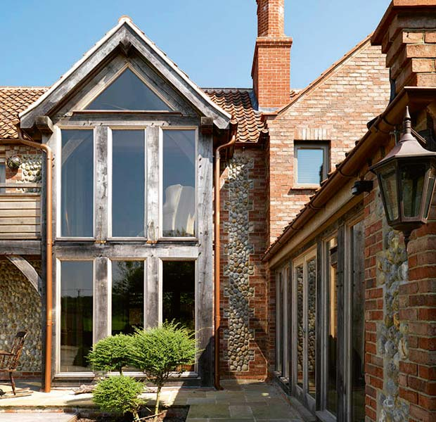 Oakwrights self-build clad in flint and brickwork