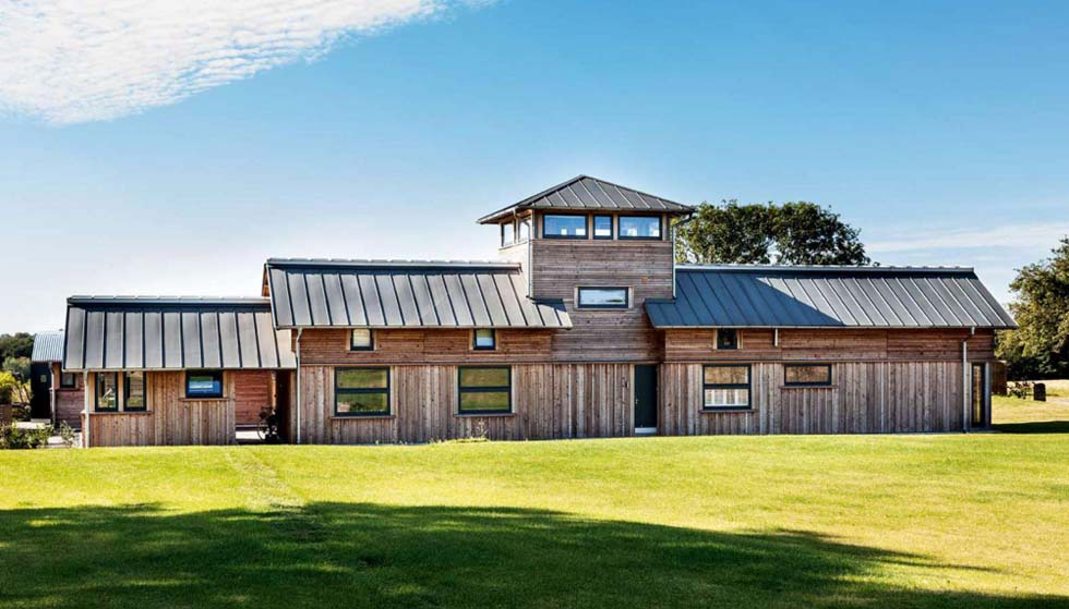 Metal roof on contemporary self build timber frame farmhouse