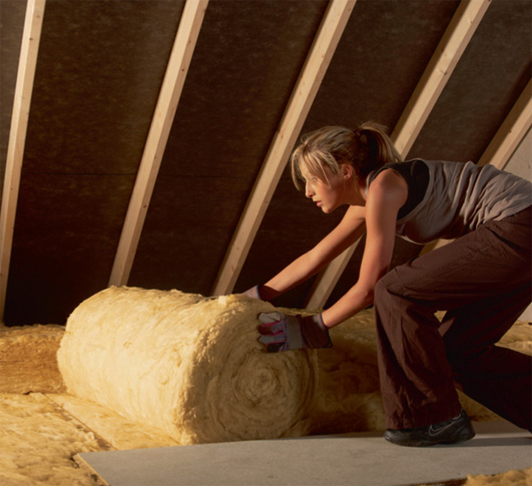 lady laying insulation