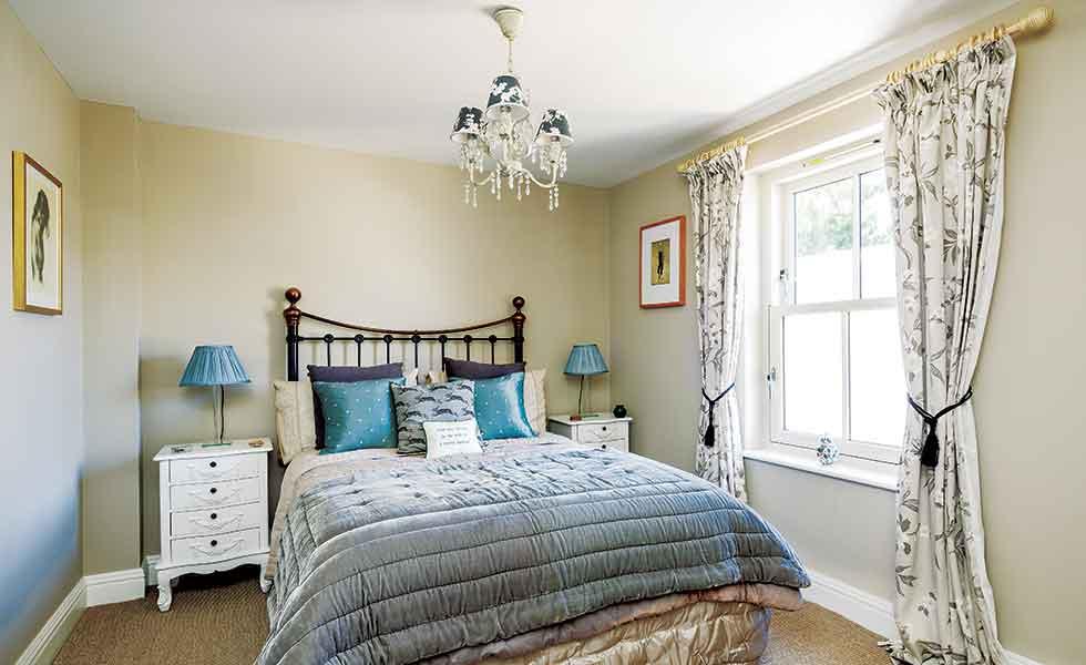 sash windows in period style bedroom
