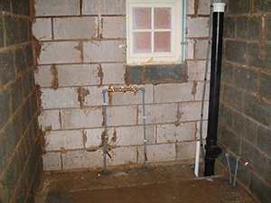 fitting the plumbing or the first fix stage in a home