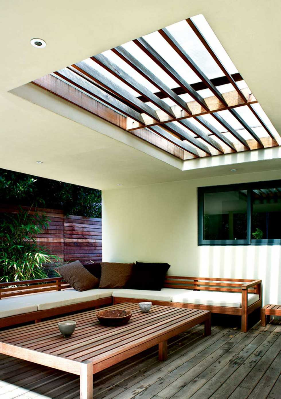 A garden room with wooden interiors and a rooflight
