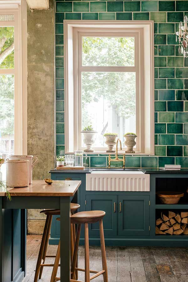 kitchen with blue tiles and ceramic sink