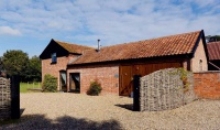 red brick L-shaped barn conversion