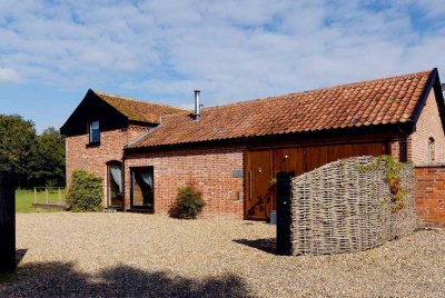 red brick L-shaped barn conversion