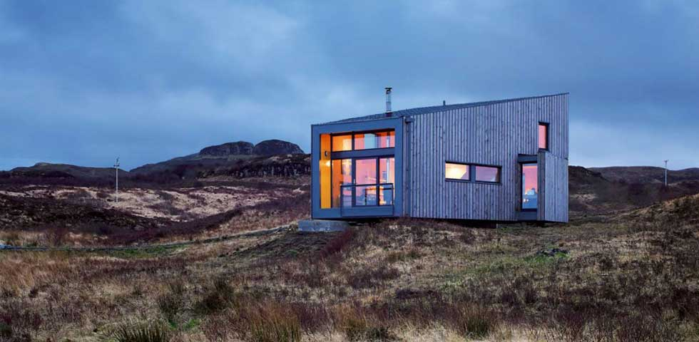 The huge window on this south-facing eco house provides plenty of natural heat