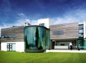 Photograph of contemporary cliffside home with glass atrium