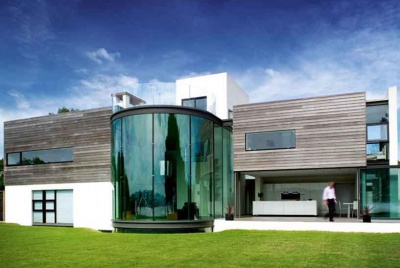 Photograph of contemporary cliffside home with glass atrium