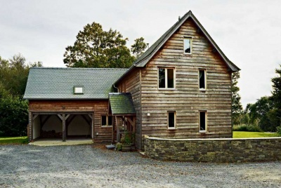 gravel driveway to a timber frame home