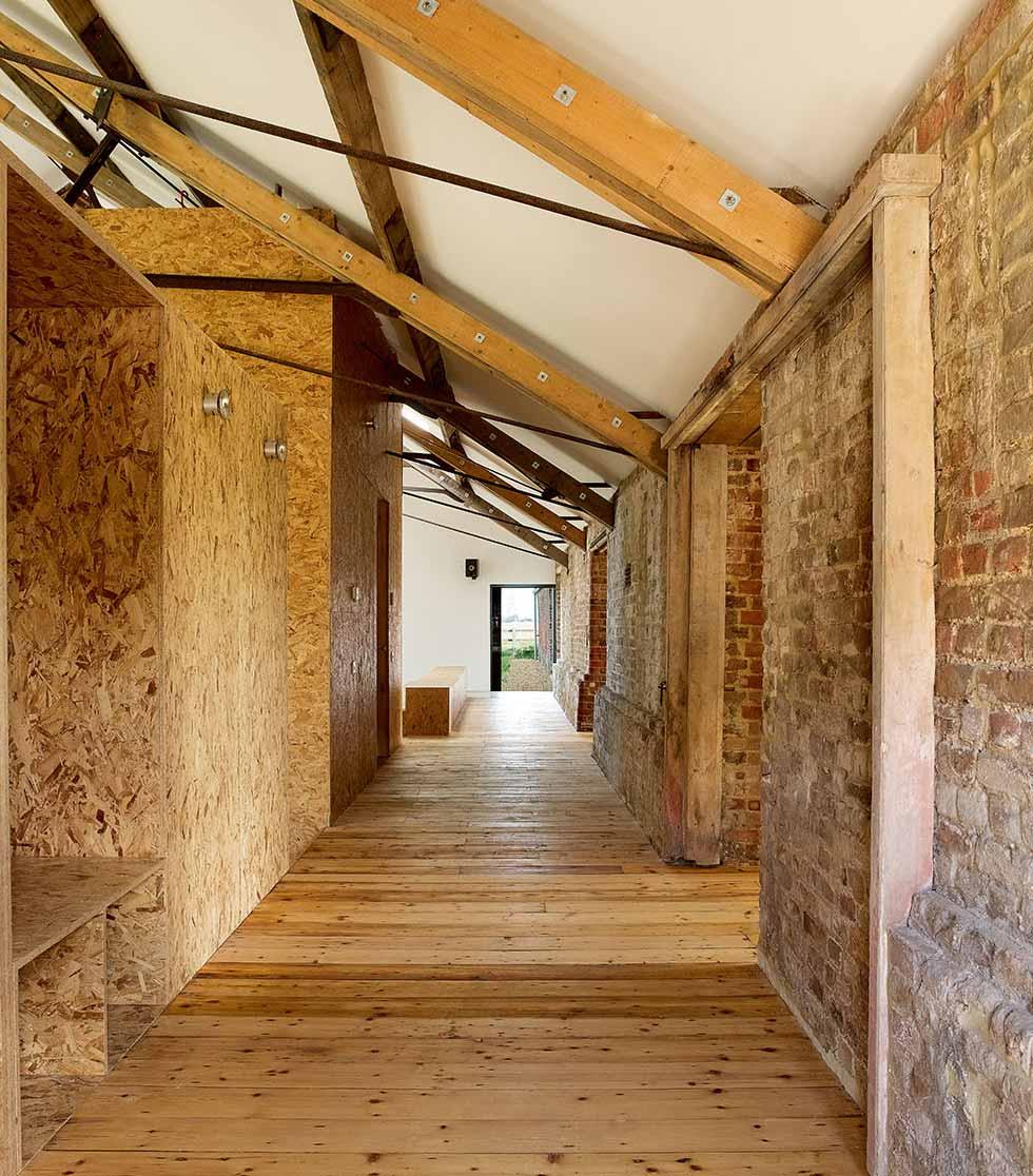 Corridor with exposed brick walls