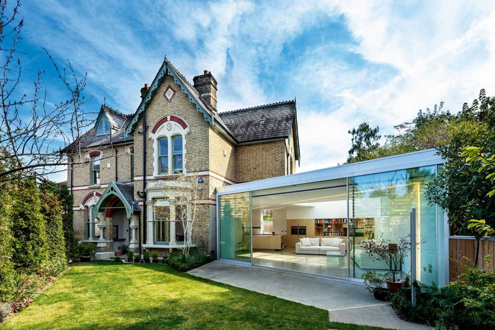 A glass kitchen extension on a Victorian house