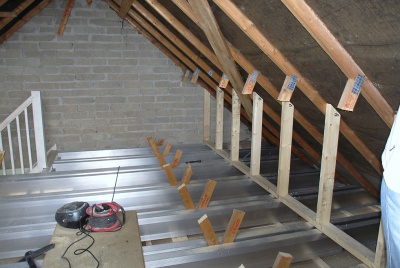 TeleBeams and stud walls in place with existing braces being cut out