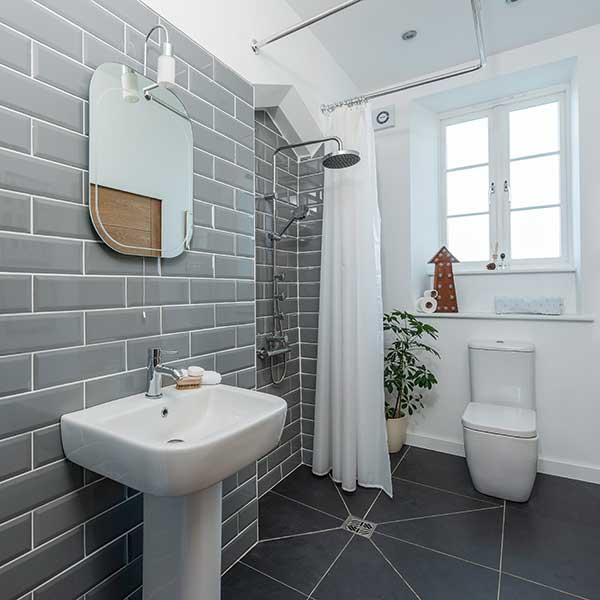 small-bathroom-with-partially-tiled-walls