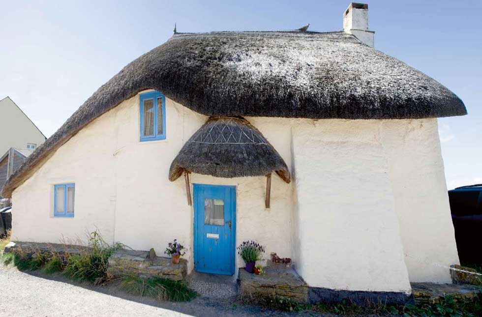 Vernacular style thatched and rendered Devonshire cottage