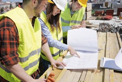 Team work with architect and construction workers