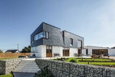 Contemporary home with timber and render cladding