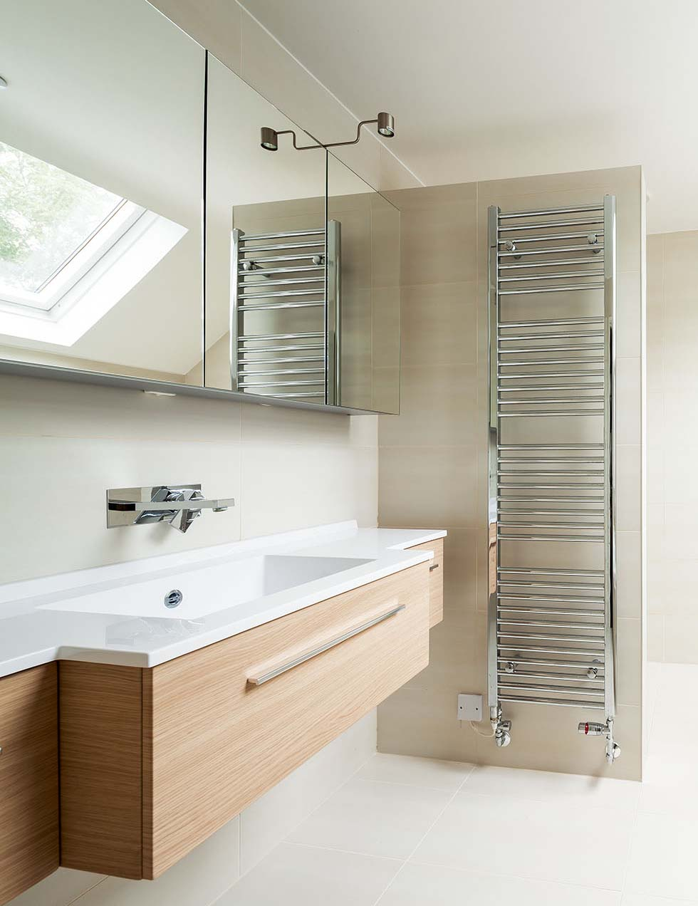 Wall-mounted heated towel rails in the bathroom