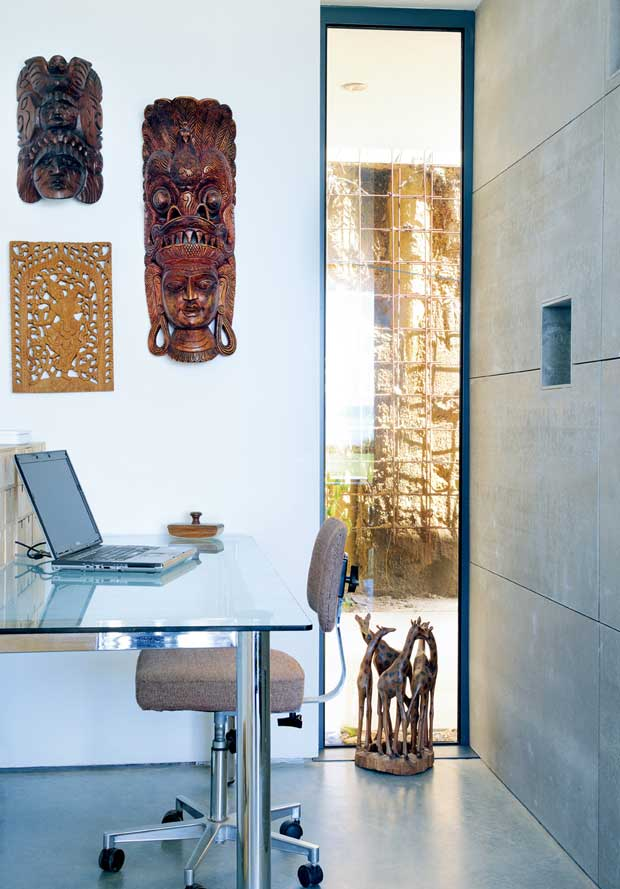 Full height vetical window provides light in the study